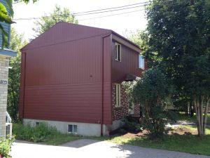 Peinture au pistolet sur maison aluminium - Québec